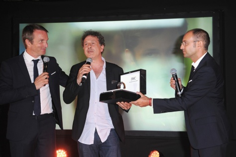 ANGOULEME, FRANCE - AUGUST 30: Stephane Rotenberg (L), Emmanuel Finkiel (C) is awared a IWC Schaffhausen watch on stage during the closing dinner?hosted by IWC during the?Festival du Film Francophone d?Angoul?me ?on August 30, in Angoul?me, France. (Photo by Francois Durand/Getty Images for IWC) *** Local Caption *** Stephane Rotenberg;Emmanuel Finkiel