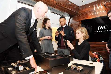 GENEVA, SWITZERLAND - JANUARY 19:   IWC head designer Christian Knoop, IWC Schaffhausen CMO Franziska Gsell, Lewis Hamilton and Rosamund Pike visit the IWC booth during the launch of the Pilot's Watches Novelties from the Swiss luxury watch manufacturer IWC Schaffhausen at the Salon International de la Haute Horlogerie (SIHH) 2016 on January 19, 2016 in Geneva, Switzerland.  (Photo by Harold Cunningham/Getty Images for IWC)