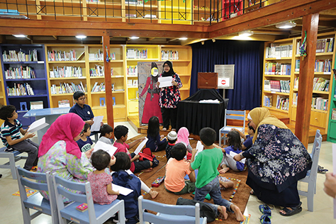 6. Children mesmerised by a storytelling session held at the IAMM Children's Library.